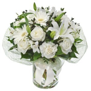 Bianca 279 White Elegant bouquet in glass vase.